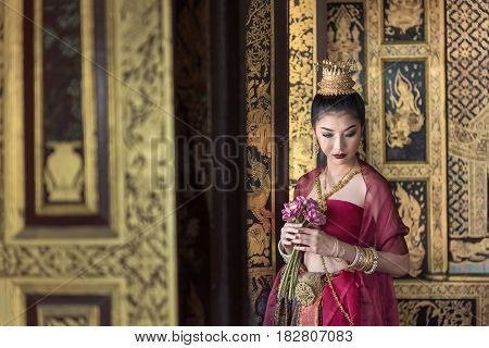 Woman in dress of Art culture Thailand Dancing