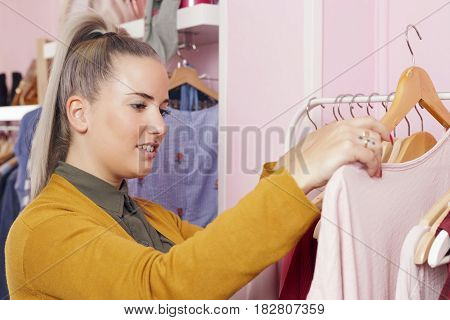 Clothing Store Owner Checking Everything Its Okay.