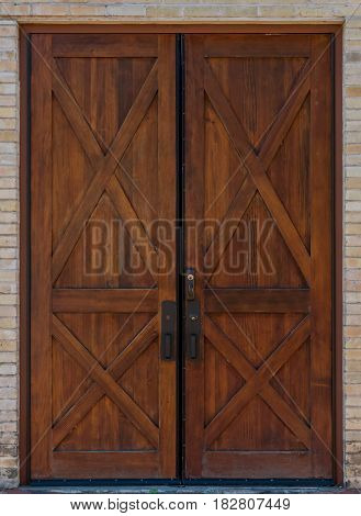 Rustic Double Wooden Door on brick building