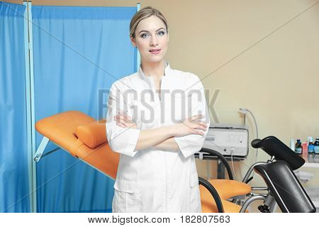 Young beautiful doctor in gynecological room