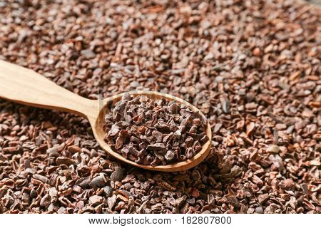 Spoon on aromatic cocoa nibs