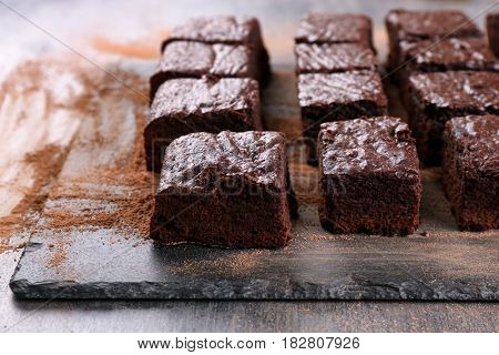 Slate plate with pieces of delicious chocolate brownie