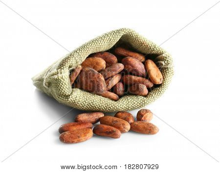 Burlap sack with aromatic cocoa beans on white background