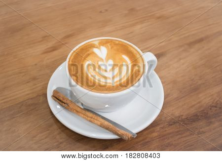 Coffee With Latte Art On Wooden Table stock photo