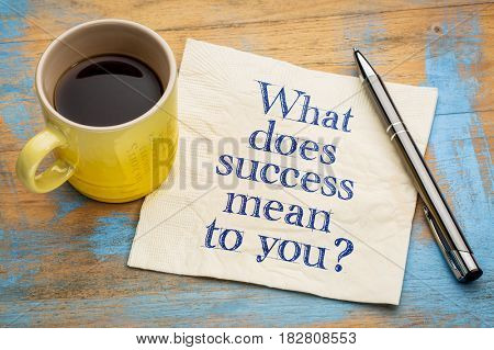 What does success mean to you?  A question on a napkin with a cup of espresso coffee.