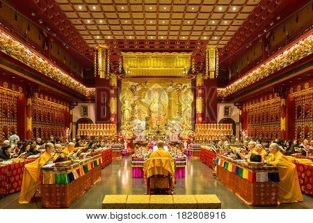 People Are Praying At Buddha Tooth Relic Temple