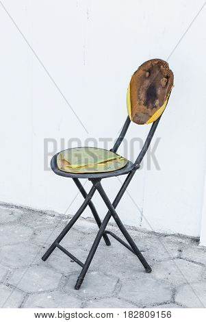 Broken Metal Wood Chair on Brick Floor