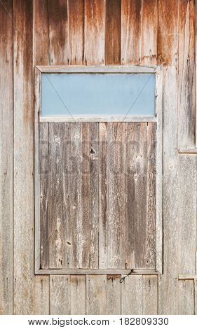 Closed Old Dirty Wood Window with Frosted Glass