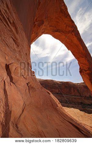 Standing next to Corona Arch in Utah.