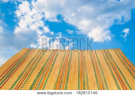 Colorful Bamboo Mat on Blue Sky Background
