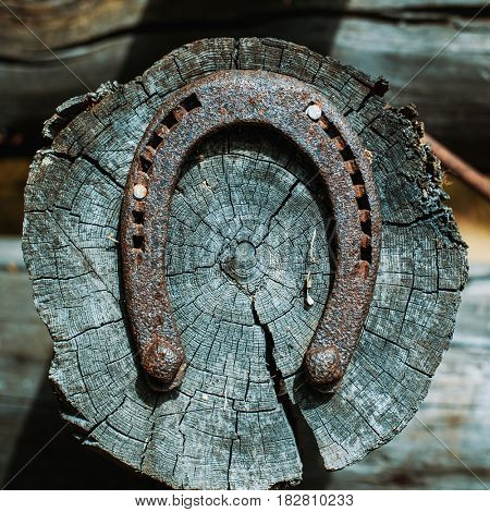 Horseshoe on house log. As a symbol of luck.