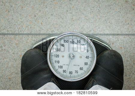 Young Man Wearing A Weighing