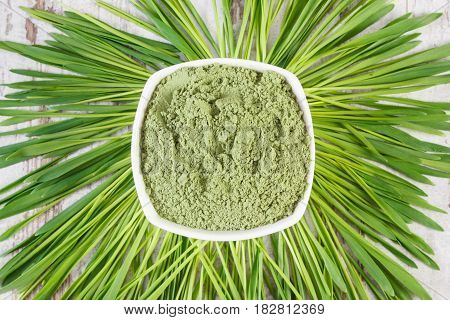 Heap Of Young Powder Barley In Dish And Barley Grass, Body Detox
