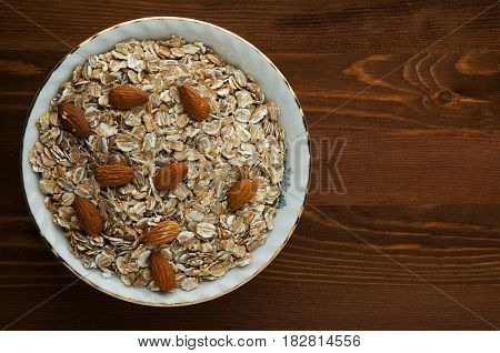 Oatmeal With Nuts. Oatmeal On A Wooden Table. Oatmeal Top View. Healthy Food .