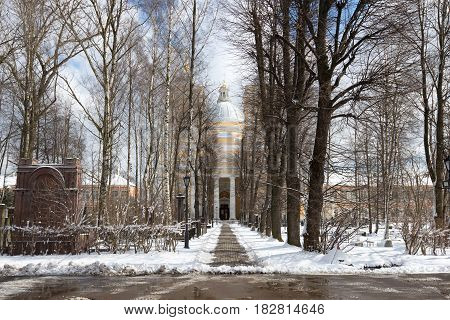Alley to the Trinity Cathedral in April afternoon. The Alexander Nevsky Lavra. St. Petersburg. Russia
