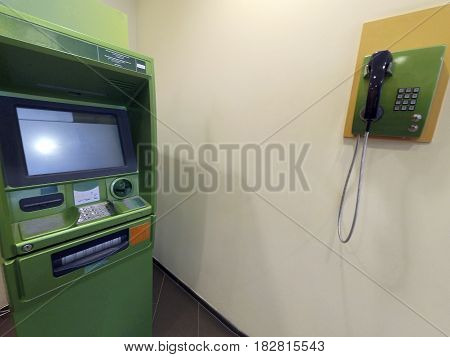 ATM for issuing money and the phone is green at the point of service