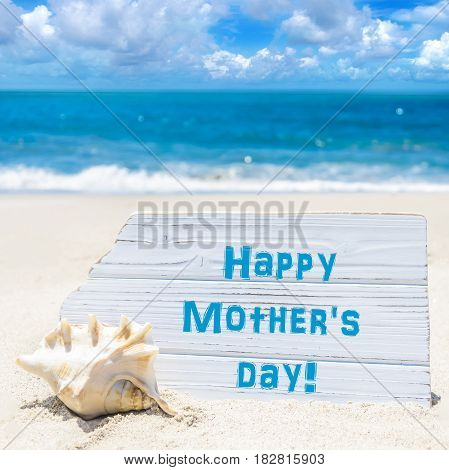 Happy mother's day background with seashell on the sandy beach near the ocean square Instagram style and format