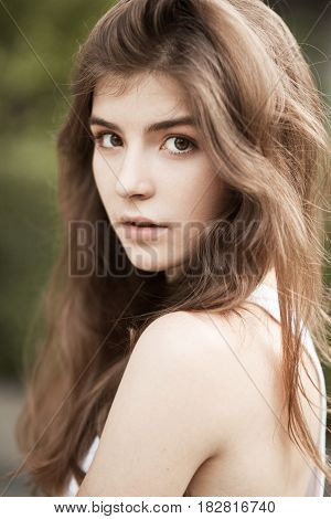 Portrait of long-haired young woman. Summer time