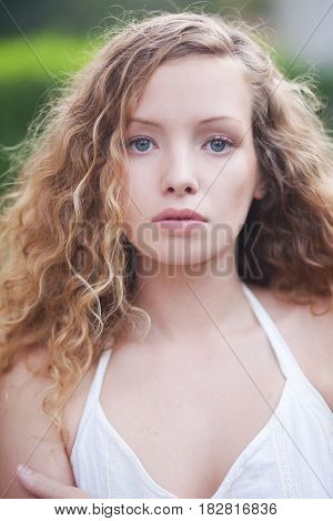 Portrait of curly noble woman. Blond woman