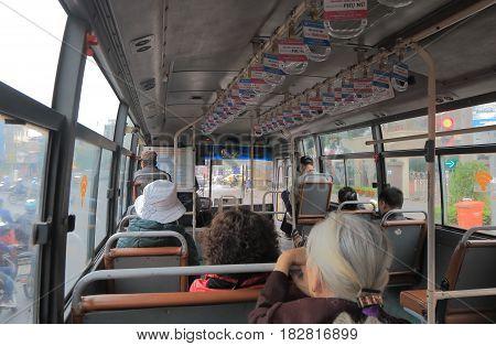 HANOI VIETNAM - NOVEMBER 25, 2016: Unidentified people travel by local bus.