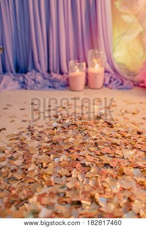 decoration of the birthday festive tinsel on the floor with lights and candles