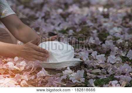 White hat placed on the flower background