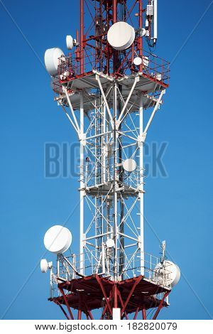 Cellular tower with antenna in red and white color