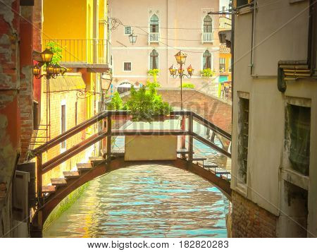 The retro stile picture of the venetian canal with bridge