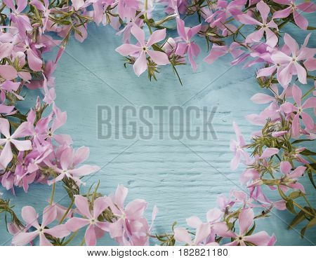 flowers in form of heart on wooden background