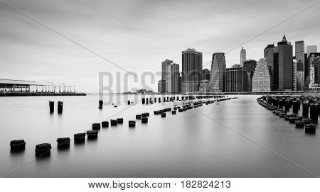 Manhattan skyline at cloudy day, black and white photo, New York, USA