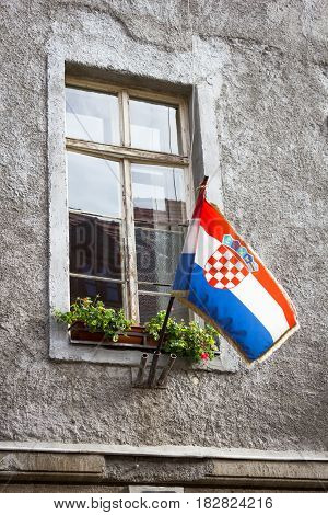 Croatian flag in the window of the old house Zagreb, Croatia