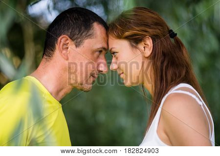 Closeup profile of father and daughter looking at each other.