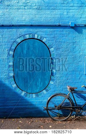 retro vintage bicycle old and blue wall background design.