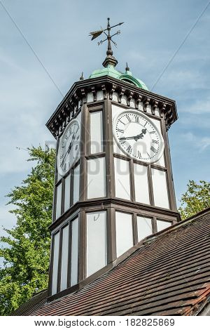 the clock tower with the pointer direction.