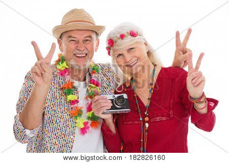 Senior couple dressed like a hippie
