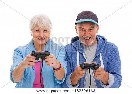 Senior couple having fun playing video games