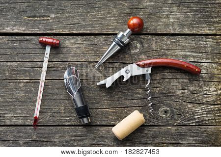 Luxury set of tools for winery on wooden table.