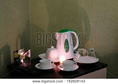 Tea set stands on a table