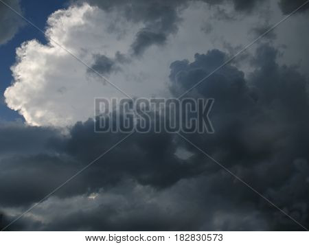 Sunlight breaking through dark thunderclouds. Dramatic or encouraging background for your design.