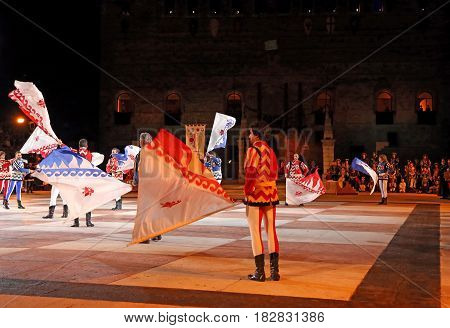 Marostica, Vi, Italy - September 9, 2016: Flag Wavers During Night Show With Evolutions Of Big Flags