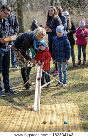 DOLE LATVIA - MARCH 27 2016: Easter holidays. Egg rolling competitions.