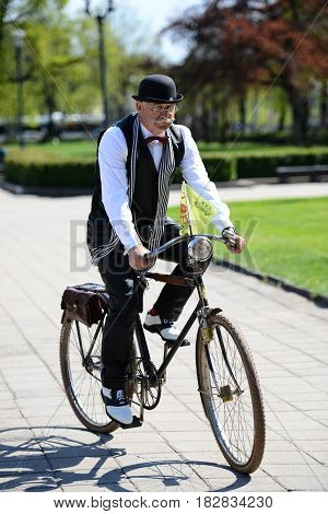 RIGA LATVIA - MAY 7 2016: Tweed ride. Unknown man driven by an old bicycle.