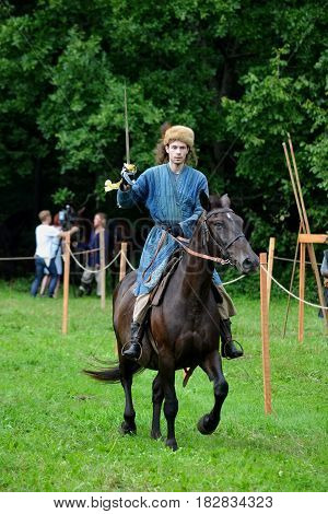 TERVETE LATVIA - AUGUST 13 2011: Historical Zemgalu days. Unknown rider on horseback in ancient clothing with ancient weapons.