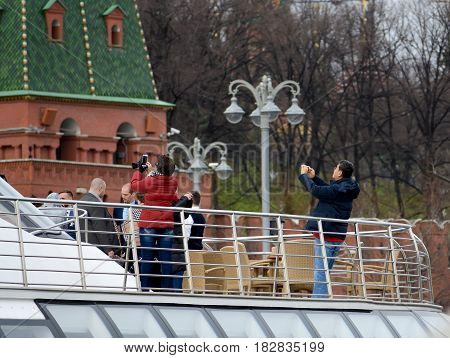 MOSCOW - APRIL 21, 2017:Tourist boat floats on the Moskva River past the Moscow Kremlin and take pictures of the Kremlin.