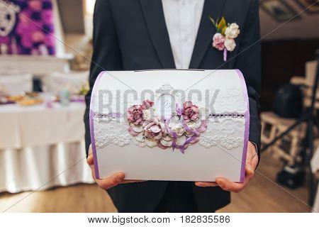 wedding box for storing money in the hands of men witness