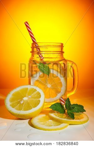 Garden mug with fresh lemonade and lemon slices