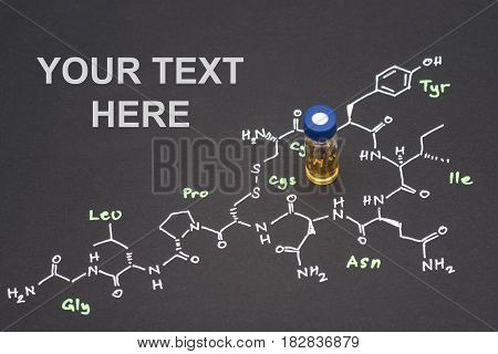 Close-up Blue Cap Sample Vial On Paper With Chemical Formula Of Oxytocin (love Hormone) With Text Sp