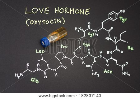 Close-up Blue Cap Sample Vial On Paper With Chemical Formula Of Oxytocin (love Hormone)