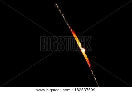 Glowing sprakler after burning at black background