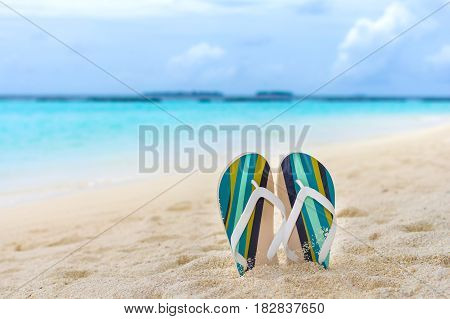 Beach slippers in the sand at Maldives